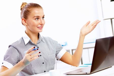 Business woman working on computer in office Stock Photo - 14731287