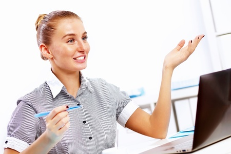 Business woman working on computer in office Stock Photo - 14731292