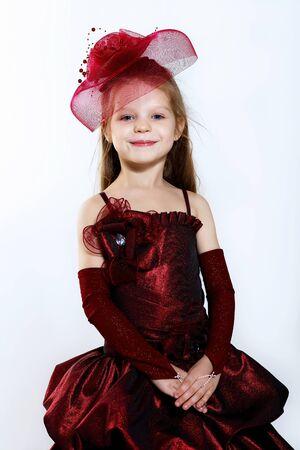 Portrait of a little girl in beautiful dress photo