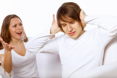 Young man and woman angry and conflicting photo