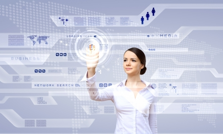 Young woman in business wear working with digital touch screen Stock Photo - 14731281