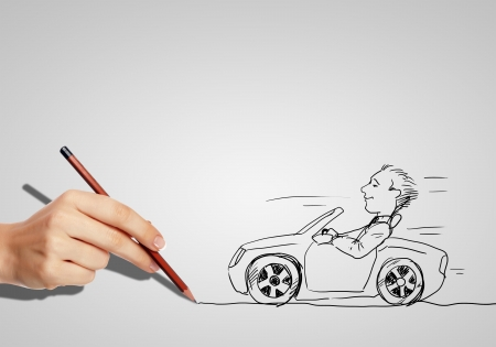 Drawing of a man in a car and hand with pencil photo