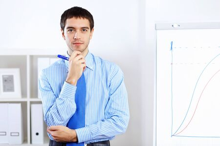 Young and successful businessman in the office Stock Photo - 14731266