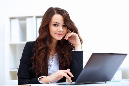 Young pretty business woman with notebook in the office Stock Photo - 14731290