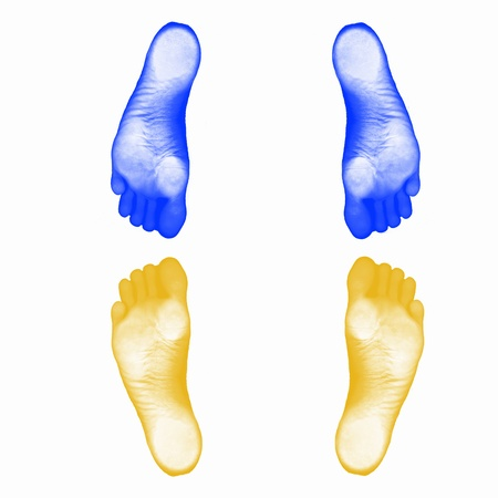 Colourful human foot prints on white background photo