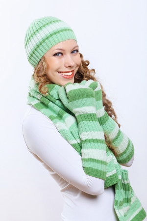 Young pretty woman in warm winter hat and scarf Stock Photo - 15185819