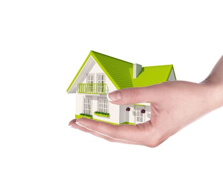 The house with colour roof in human hands Stock Photo - 15185519