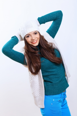 warm clothes: Young pretty woman in warm winter hat and scarf Stock Photo