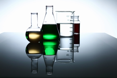 chemical industry: Glass chemistry tubes on a colour background