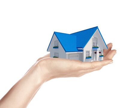 The house with colour roof in human hands Stock Photo - 15204583