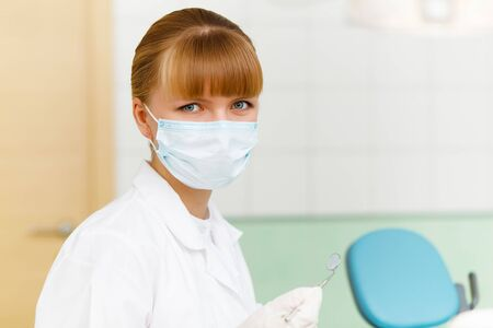 A portrait of a dental worker, dentist or assistant  photo