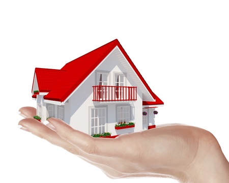 The house with colour roof in human hands Stock Photo - 15204707