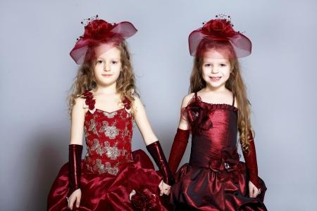 Portrait of two little girls in beautiful dresses photo