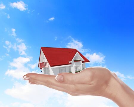 The house with colour roof in human hands Stock Photo - 15186941