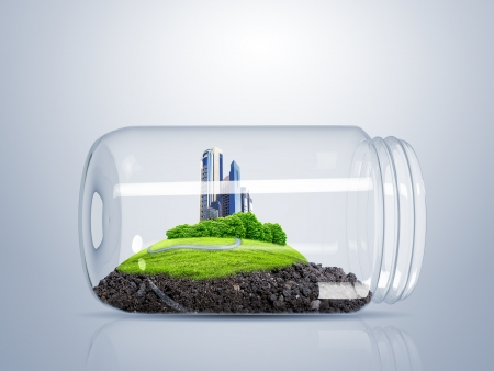 clean street: Green city on the hill inside a glass jar