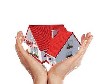 The house with colour roof in human hands Stock Photo - 15186247