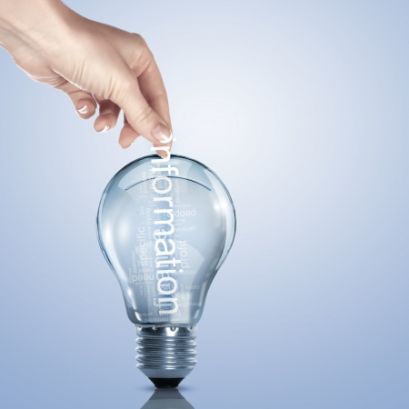 Human hand putting word Information inside a light bulb Stock Photo - 15204592