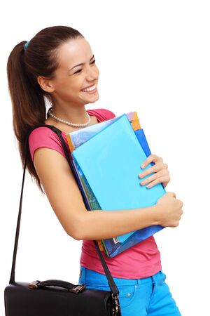Happy smiling student standing and holding books photo