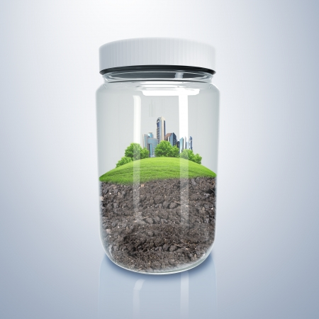 Green city on the hill inside a glass jar photo