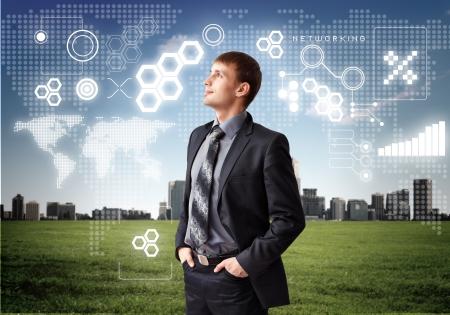 Imagen de hombre de negocios con s�mbolos digitales photo