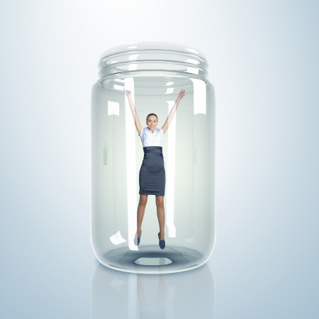 Businesswoman trapped inside a transparent glass jar Stock Photo - 15187102