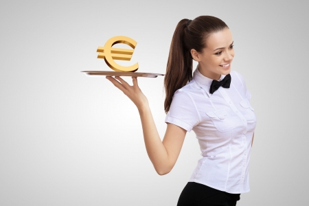 Waitress holding a tray with money on it Stock Photo - 15187095