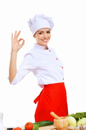 Young cook preparing food wearing a red apron photo