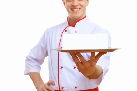 Male cook in uniform holding an empty tray photo