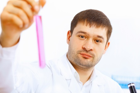 Young male scientist working with liquids in laboratory Stock Photo - 14889773