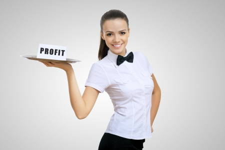 Waitress holding a tray with word profit on it photo
