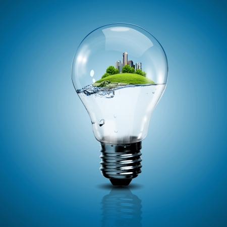 renewable energy resources: Electric light bulb and a plant inside it as symbol of green energy