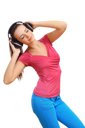 Happy smiling girl dancing and listening to music photo