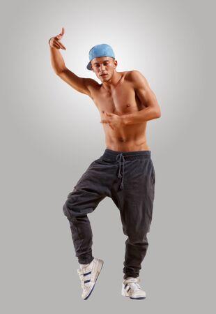 young man in a blue cap dancing hip hop photo