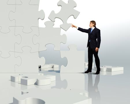 Businessman with a puzzle pieces on the background photo