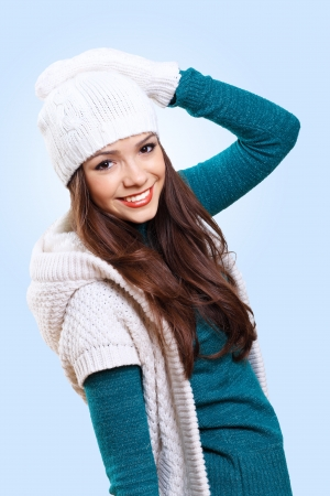 Young pretty woman with lomng hair wearing warm pullover photo