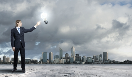 the future growth: Image of a business man standing against cityscape