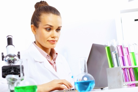 Young female scientist working with liquids in laboratory Stock Photo - 14954296