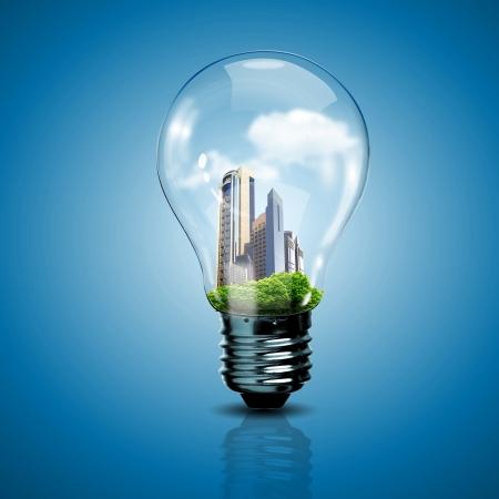 Elektrische gloeilamp en een plant erin als symbool van groene energie