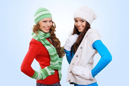 Two girls in bright and warm winter wear photo