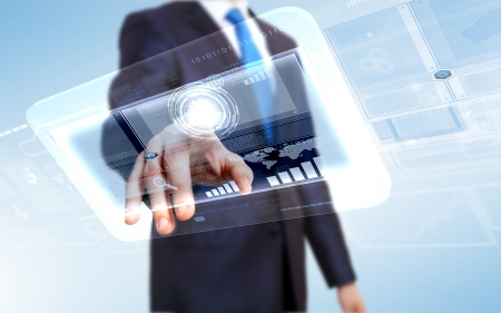 Businessman in blue suit working with digital vurtual screen photo