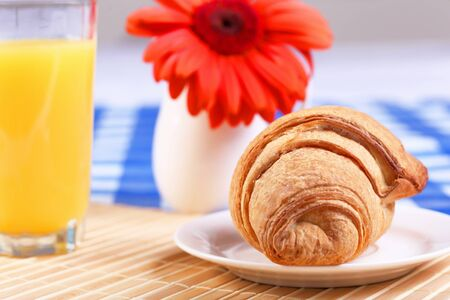 Continental breakfast with croisant and orange juice