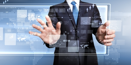 information science: Businessman in blue suit working with digital vurtual screen