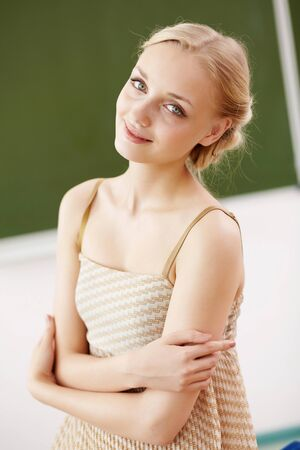 Young female teacher standing near blackboard at school Stock Photo - 14955110