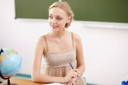 Young female teacher working with children at school Stock Photo - 14954991