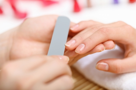 manicure woman: Young woman is getting manicure in a beauty salon