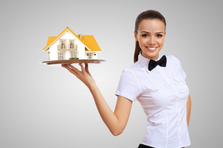 real estate background: Waitress in white shirt with a tray and house on it