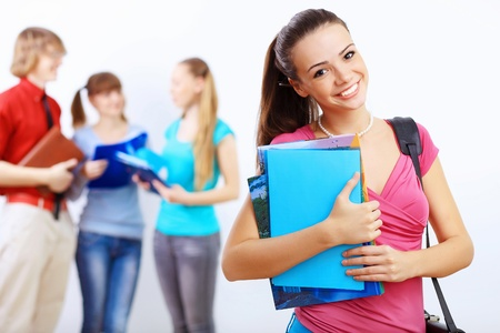 1 and group: Young female student at college with books
