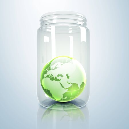 Image of our planet earth inside a glass jar photo