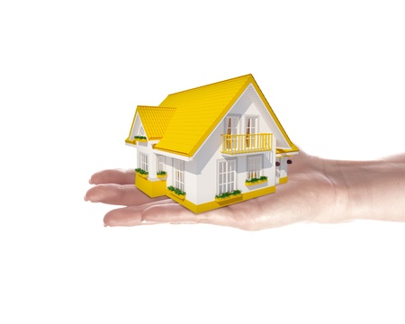 The house with colour roof in human hands Stock Photo - 15215577