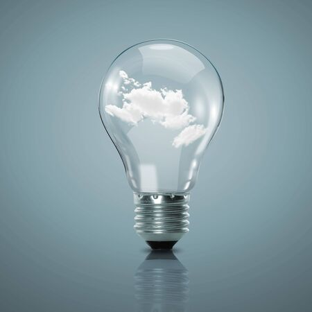 Electric light bulb and blue sky with clouds inside it photo
